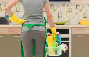 Maid service lady about to clean kitchen